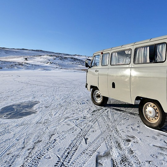 Van on a frozen lake